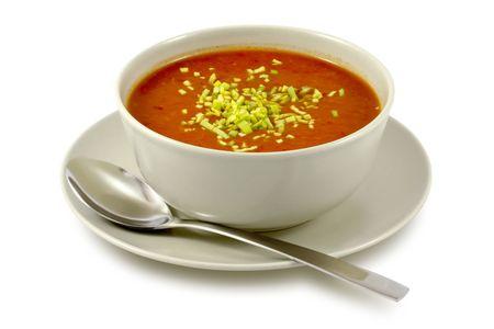 spoon yellow: Delicious, creamy tomato soup in ceramic bowl on white Stock Photo