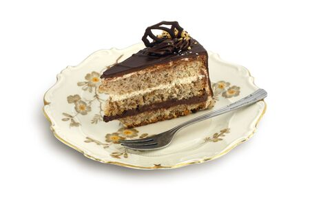 Chocolate cake with nuts on old, stylish plate