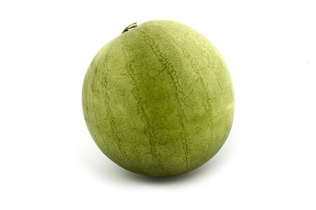Green, fresh, striped whole melon on white