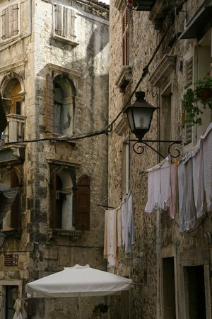 Street laundry in the narrow, Mediterranean street Stock Photo