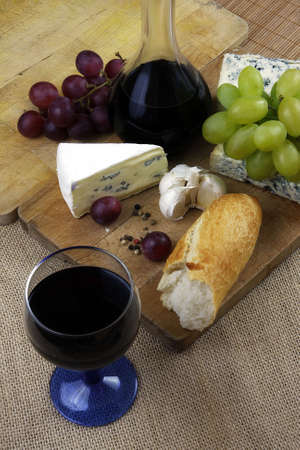 dinner with wine and cheese on rustic board