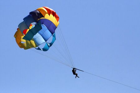 Colorful parachute on a blue sky at the summertime