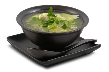 Tasty broth served in stylish; black bowl; on white; isolated