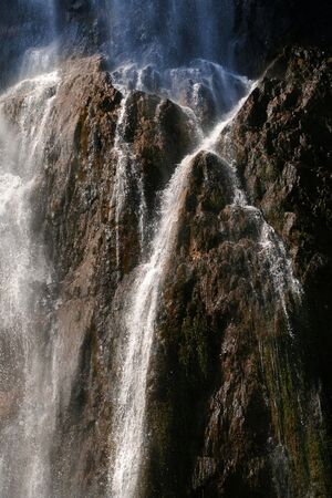 Beautiful, sunny waterfall in the national park Stock Photo