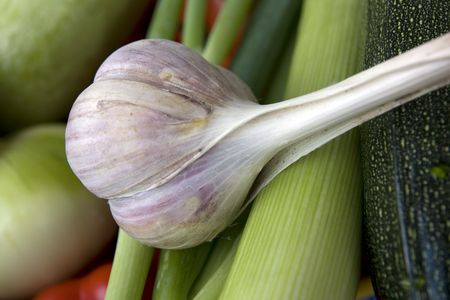 Fresh, tasty garlic on the green vegatables