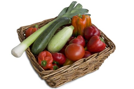 Wicker basket full of fresh, colorful and tasty vegetables Stock Photo