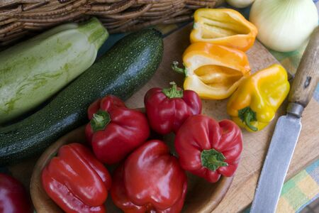 Fresh, colorful vegetables on the wooden rustic board just before the cooking Stock Photo