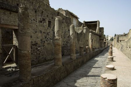Ancient, stone street in Herculaneum at the sunny noon