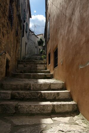 Narrow street in old, mediterranean town in Croatia