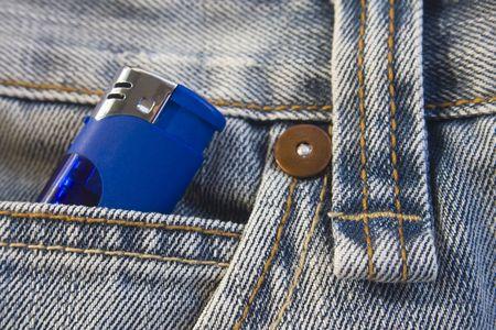 Blue lighter in washed, stylish jeans pocket