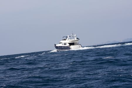 Cabin cruiser at the middle of the sea Stock Photo