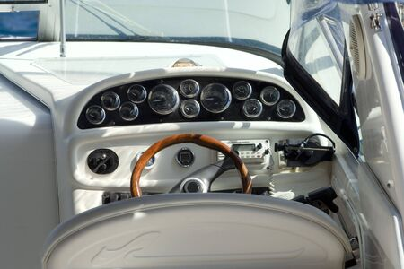 Steering wheel of modern engine boat, close up
