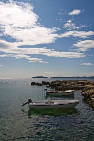 Two, lonely boats in the rocky bay Stock Photo