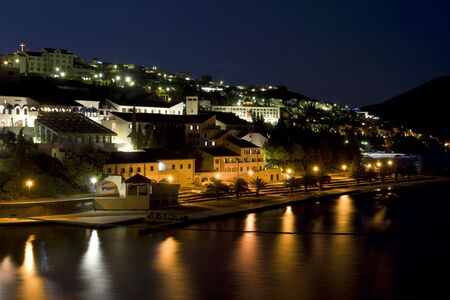 Seaside resort by night, illuminated by street lamps