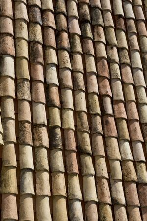 Old roof covered by vintage, clay tile Stock Photo
