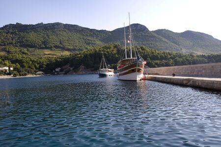 Two vintage, wooden ships in the small port Stock Photo