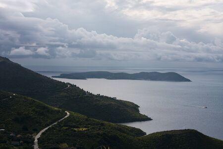 Mediterranean, narrow, seaside road among mountains