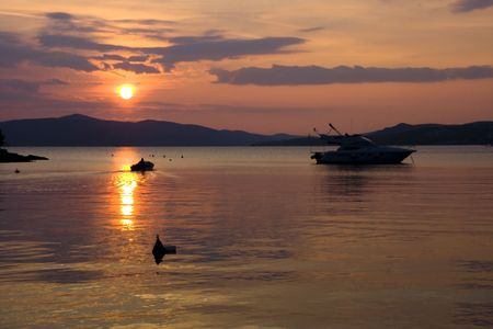 Sunset at the small bay against a background of mountains