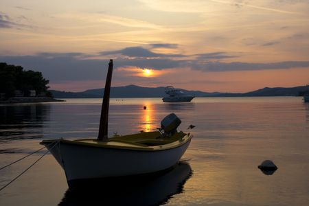 Moored boat in the rays of sunset 写真素材