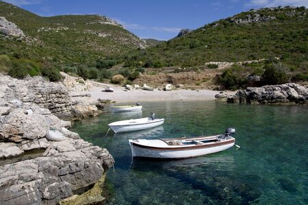Fishing boats in the small, rocky bay Stock Photo
