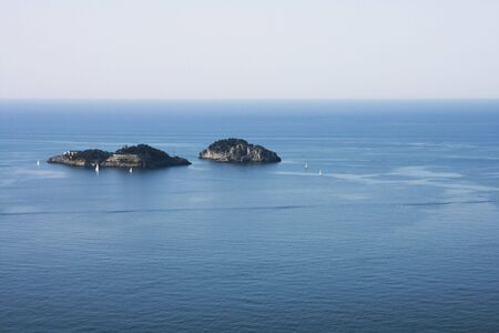 Two islands somewhere at the blue sea Stock Photo