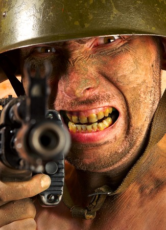 The soldier in a military helmet  photo