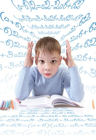 The boy with the book behind a table on a white background Stock Photo - 1413572