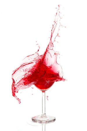 Broken a glass with wine on a white background photo