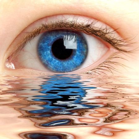 bloodshot: Human eye reflected in a surface of water  Stock Photo