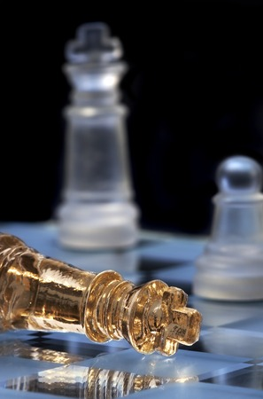 defeat: Chess king lays on a chessboard. A victory and defeat...
