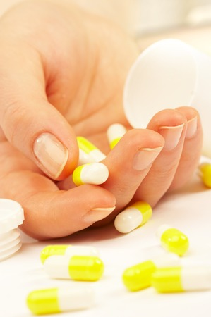 Female hand with tablets. Suicide.