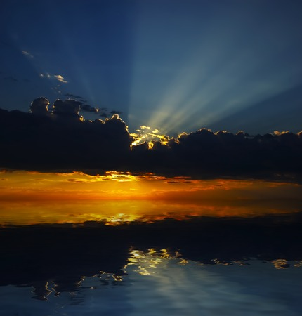 the setting sun: Evening decline above the sea  Stock Photo