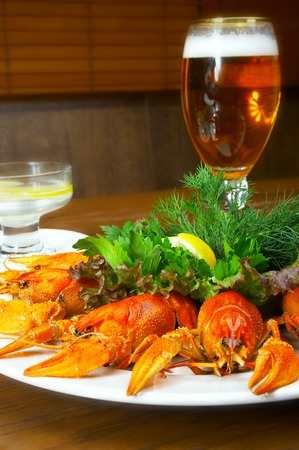 riverine: Crayfishs with beer on a table at restaurant.