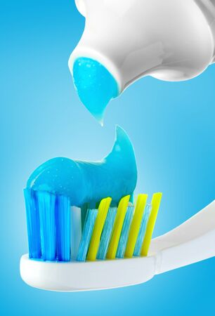 Dental brush and tube with paste. photo