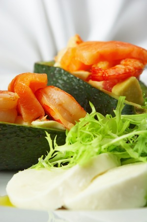 Tasty Dish behind a dining table.Cold snack... photo