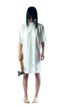 terror: The girl with an axe and wet hair... Stock Photo