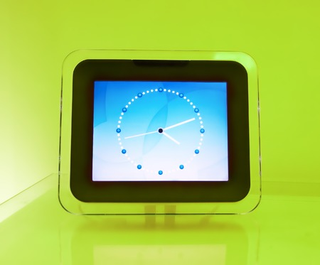 analogue: Blue electronic hours, on a green background...
