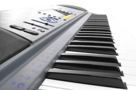 synthesizer: Keys of a synthesizer in white bright light...