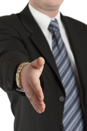 concludes: The businessman concludes the transaction, stretches a hand... Stock Photo