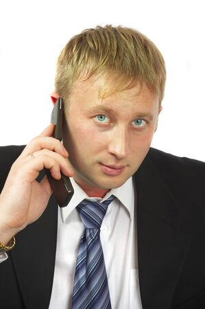 conducts: The businessman speaks by phone. Conducts conversation.