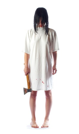 horrific: The girl with an axe and wet hair... Stock Photo