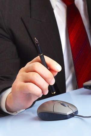 Mans hand with a  pen. The businessman  photo