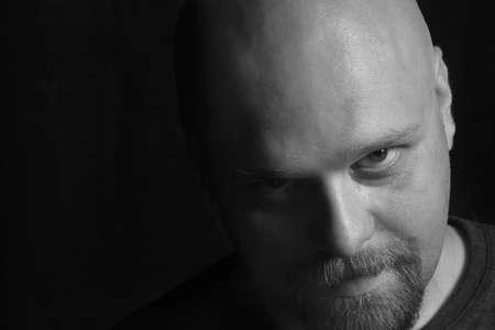 furtive: bald-headed Man