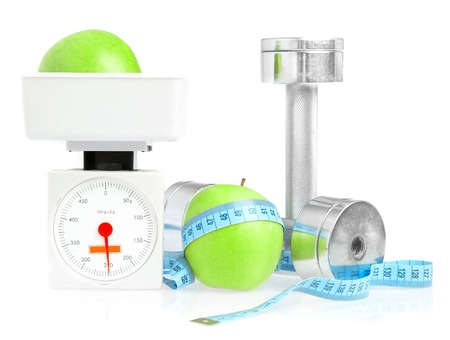 Dumbbells with an apple on a white background. A healthy way of life photo