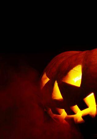A scary old jack-o-lantern on black. Stock Photo - 1646388