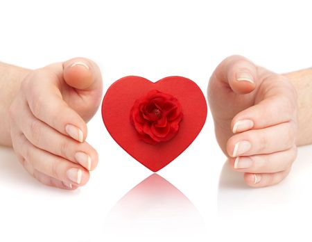 Human hands and heart on a white background Stock Photo - 2407190