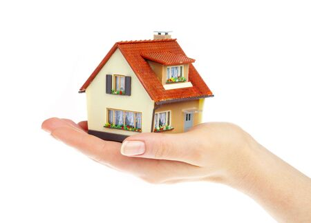 The house in human hands Stock Photo