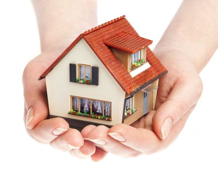 home ownership: The house in human hands Stock Photo