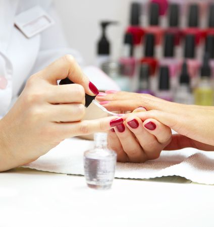 red nail: Manicure process... Female hands...