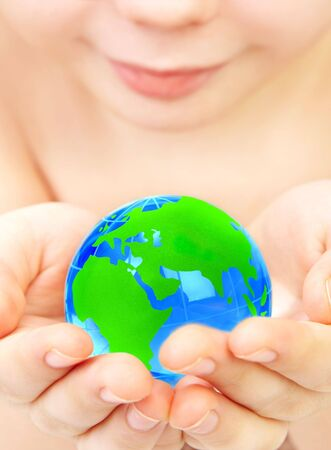 The boy holds globe in hands Stock Photo